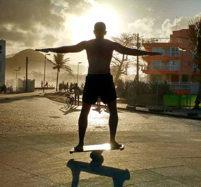 silhouette of man on a balance board