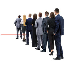 business people in a line with the leader at the end
