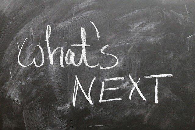 blackboard showing words in chalk: What's next